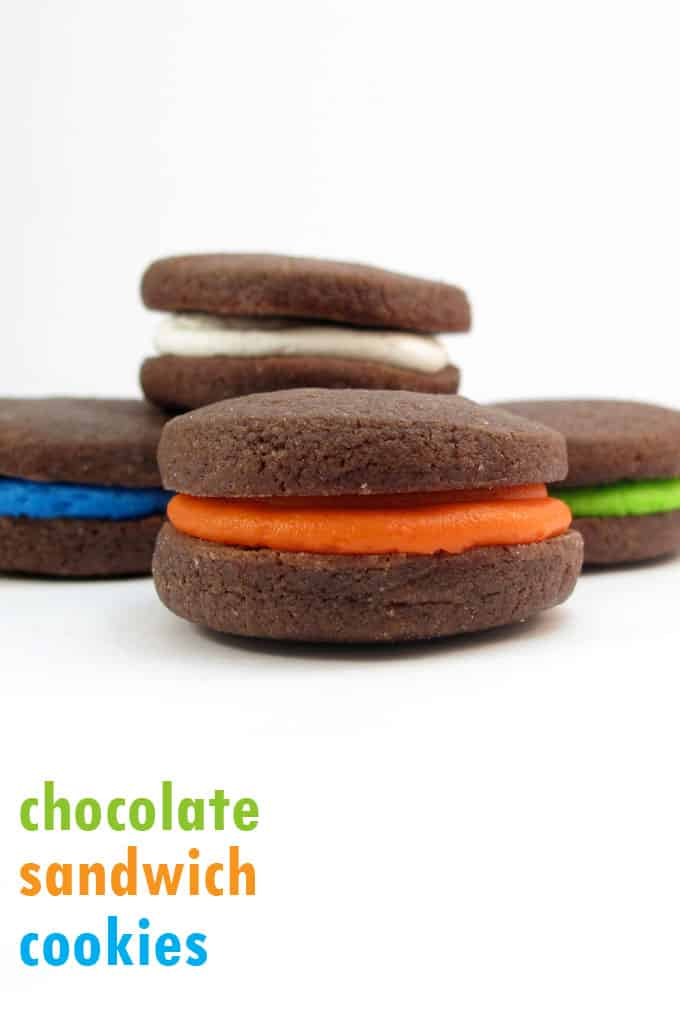 Chocolate sandwich cookies filled with colorful icing, and a recipe for cut-out chocolate sugar cookies. #SandwichCookies #chocolate