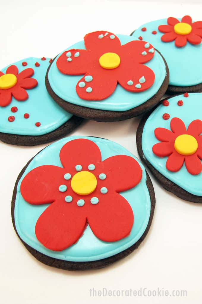 Beautiful red and aqua chocolate flower cookies with royal icing and fondant