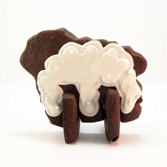 Lamb cookies: How to make 3D standing lamb cookies for Easter with chocolate cut-out cookie dough and delicious royal icing.