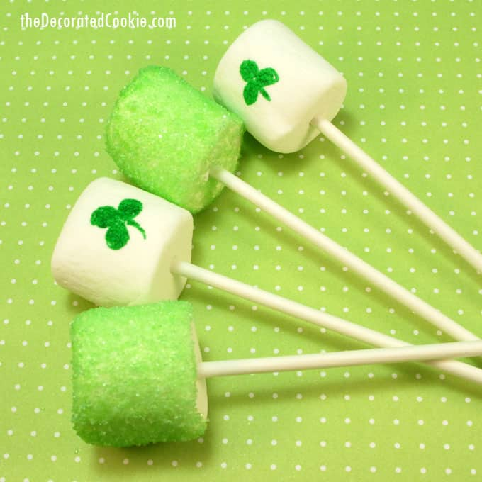 Fun food idea for St. Patrick's Day: St. Patrick's Day marshmallows with sprinkles and food coloring pens - by TheDecoratedCookie.com -- #StPatricksDay #StPatricksDayParty #StPatricksDayFoodIdeas #marshmallows #GreenFood