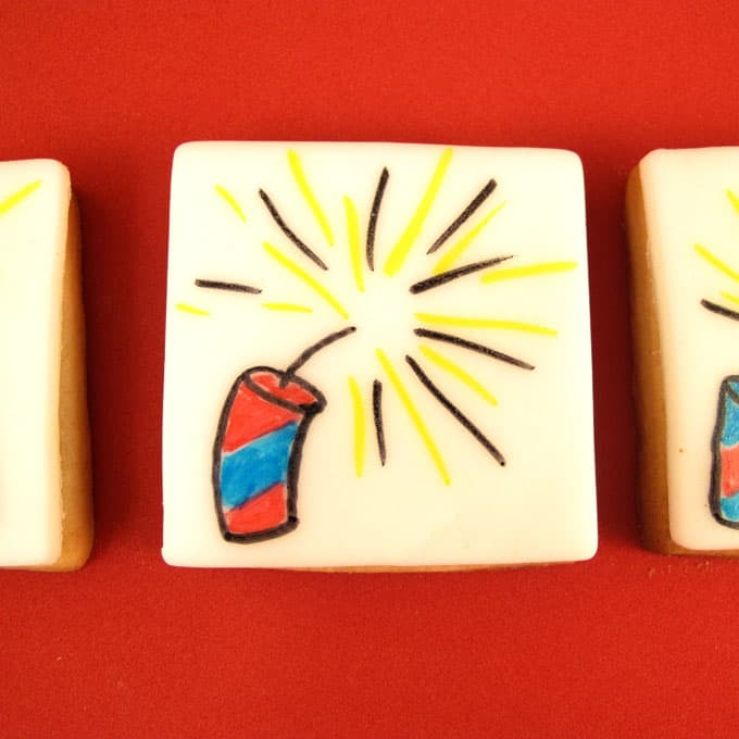 firecracker cookies for the 4th of July: How to draw a firecracker on a cookie topped with royal icing for fondant.