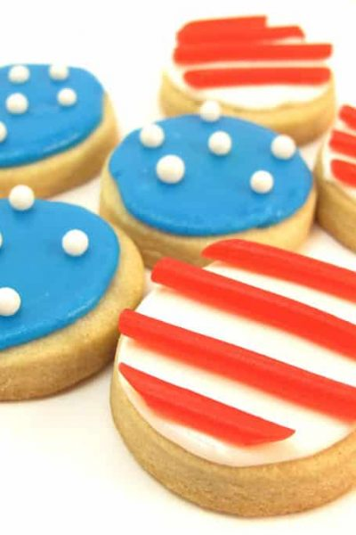 Stars and stripes cookies -- How to decorate bite-size 4th of July cookies with sprinkles and store-bought candy. #4thofJuly #DecoratedCookies #4thOfJulyCookies #StarsandStripes #AmericanFlag