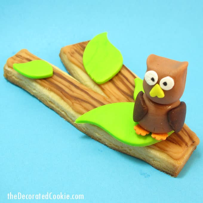 Fall cookie idea: Tree branch cookies with a painted wood grain and a fondant owl. #Fondant #Owls #TreeBranchCookies #CookiePainting #FallCookies