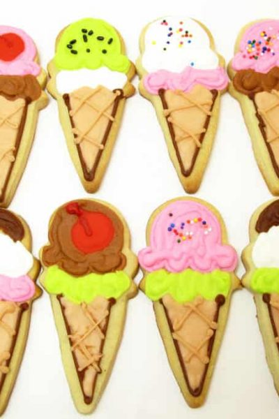 How to decorate ice cream cone cookies, a fun summer treat! Decorated sugar cookies with royal icing and sprinkles. #Icecreamcones #Summerdessert #CookieDecorating #IceCreamCookies