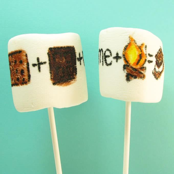 "s'mores marshmallow art: how to draw ""s'mores"" on marshmallows with food coloring pens for a fun summer treat idea #smores #marshmallows #summer"