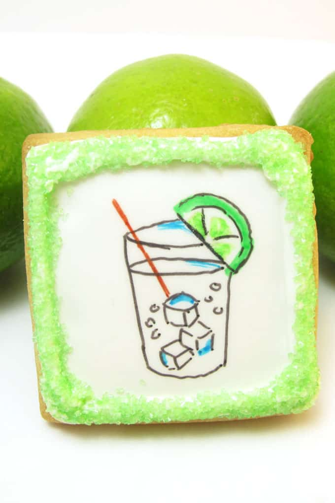 Gin and tonic cookies: How to  use food coloring pens to draw a gin and tonic on decorated cookies flooded with royal icing.  #ginandtonic #cookies #cookiedecorating