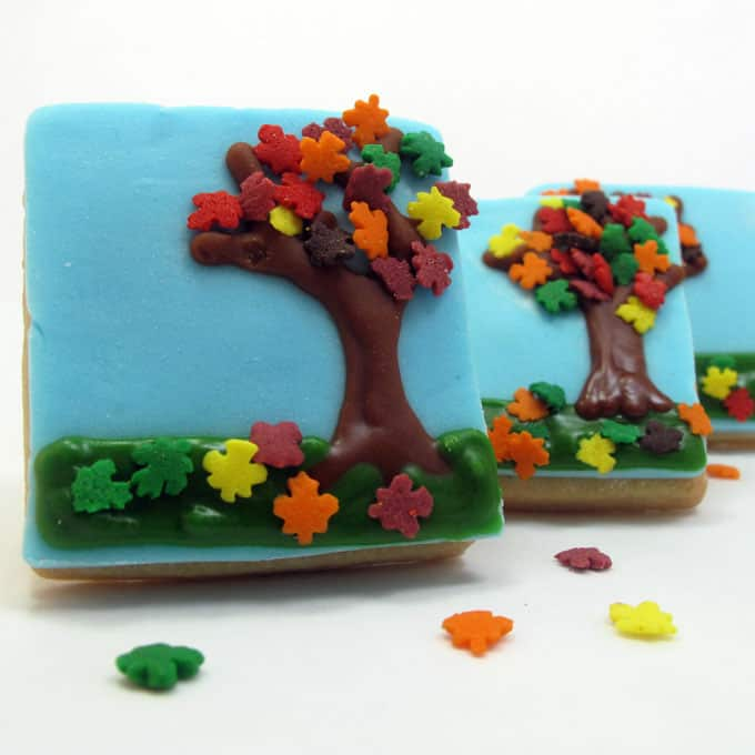 Fall tree cookies: Cute cookies for Fall, use leaf sprinkles, fondant, and royal icing to decorate easy fall tree cookies. #falldesserts #fallcookies #trees #leaves #leafsprinkles #cookiedecorating