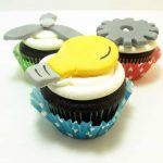 Machine cupcakes: Cupcakes topped with fondant light bulbs, fans, and gears, for a boy's birthday party. #Machines #BoyBirthdayParty #Cupcakes #BirthdayCupcakes #Fondant