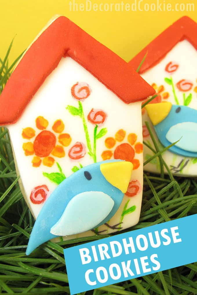 painted birdhouse cookies with yellow background