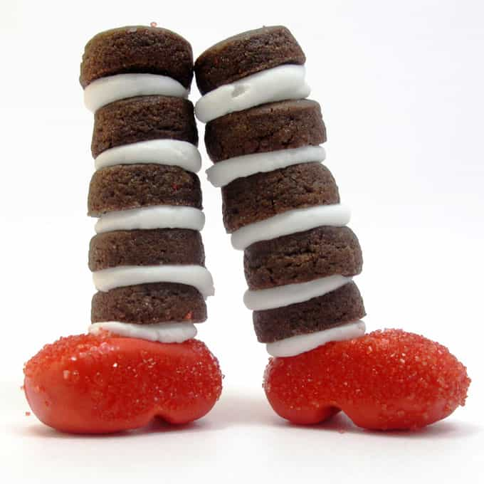 Wizard of Oz cookies: Mini chocolate cookies with fondant ruby slippers to look like the witch's legs from the Wizard of Oz #WizardOfOz #Cookies #WickedWitch #Halloween