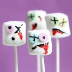 The original ZOMBIE MARSHMALLOWS on a stick for a spooky Halloween party food or for The Walking Dead party. All you need are food pens and sprinkles. #zombie #marshmallows #halloween #halloweenparty #funfood #halloweenfood #candy