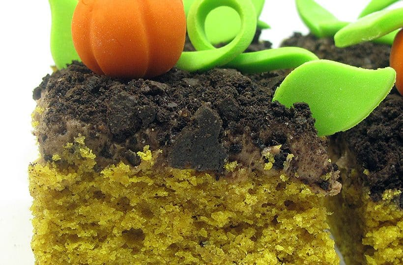pumpkin cake with chocolate cream cheese frosting with a fondant pumpkin patch