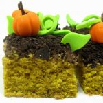 pumpkin patch cake topped with chocolate cream cheese frosting, crumbled chocolate cookies and fondant decorations -- awesome Thanksgiving dessert #ThanksgivingDessert #FallDessert #PumpkinCake #PumpkinPatch #Linus