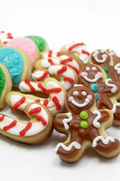 Mini Christmas candy cookies are handy for packaging in little jars for a homemade holiday gift idea. Decorated cookie ideas for Christmas. #christmascandy #cookiedecorating #Christmascookies #Cookiepackaging #minicookies