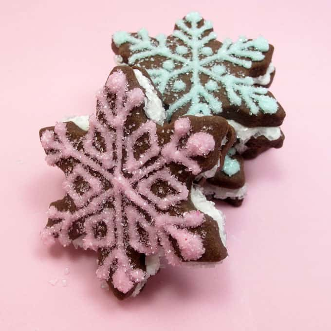 Chocolate snowflake sandwich cookies are a sparkly, beautiful decorated cookie to make this holiday season for Christmas or winter.