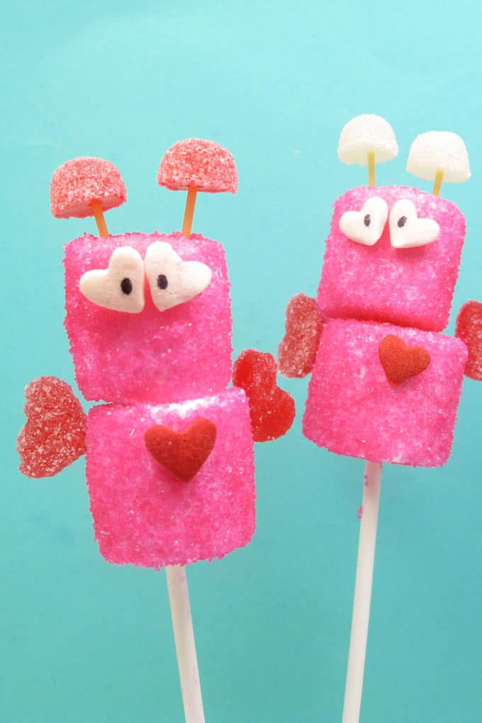 Cute marshmallow love bugs, candy treats for Valentine's Day by the decorated cookie. #lovebugs #ValentinesDay #Treats #marshmallows #Bugs
