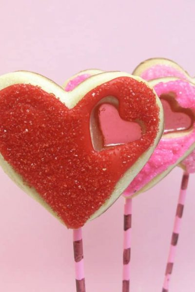 stained glass heart cookie pops for Valentine's Day -- the decorated cookie #ValentinesDay #cookies #heartcookies #stainedglasscookies