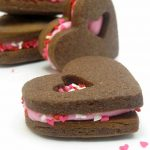 chocolate heart Valentine's Day sandwich cookies -- the Decorated Cookie #heartcookies #valentinesday #chocolatecookies #sandwichcookies #sprinkles