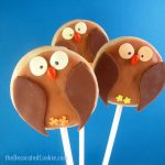 owl cookies on a stick with fondant and royal icing, a fun food treat for fall or Halloween -- the decorated cookie
