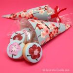 painted cherry blossom cookies and paper cones