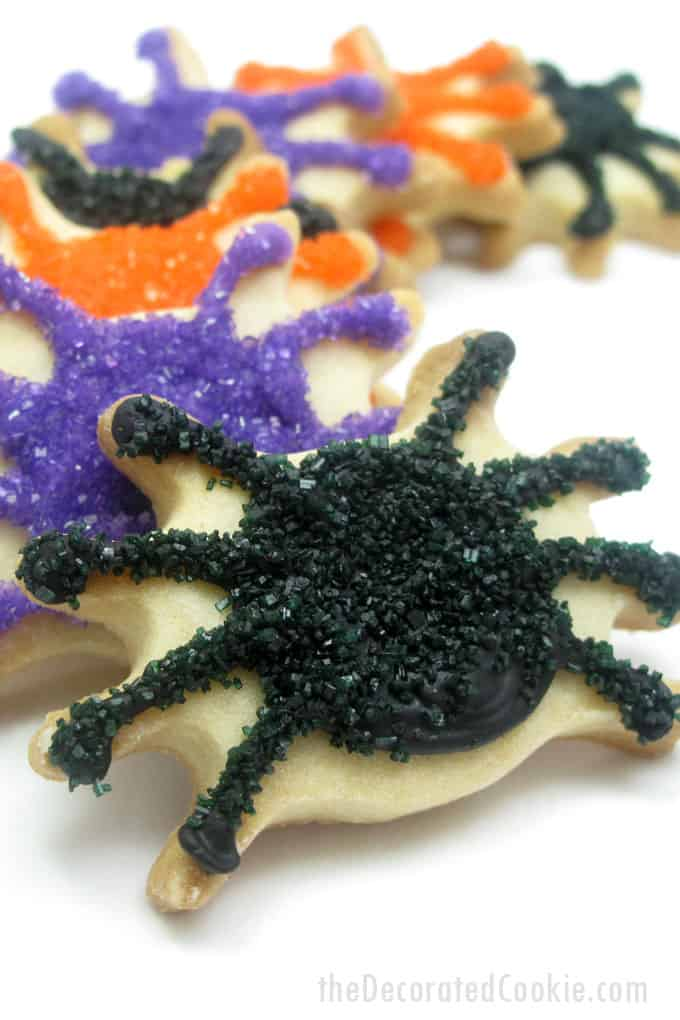 Halloween spider cookies -- using sprinkles and icing makes decorating cookies easier! Perfect fun food for your Halloween party.