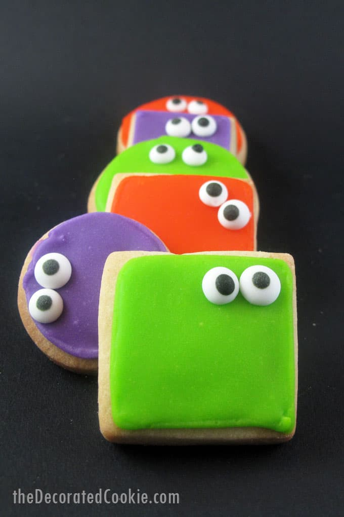 Super-simple googly-eyed monster cookies for a fun Halloween treat. Simple royal icing with store-bought candy eyes is a quick and easy way to decorate.