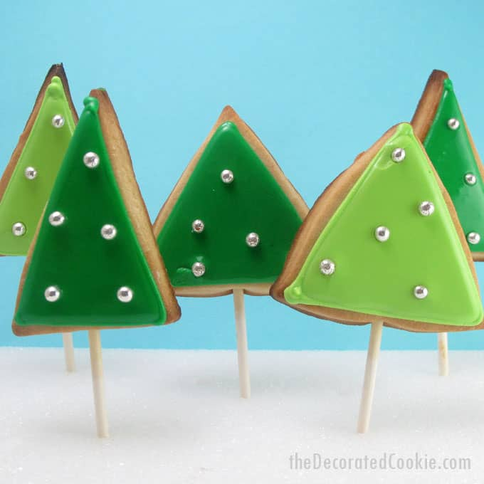 This simple forest of Christmas tree cookies gives decorated Christmas cookies a mod, retro feel. Step-by-step cookie decorating instructions.