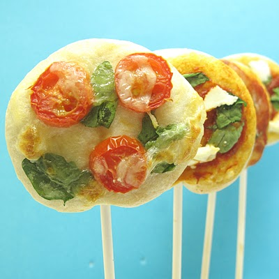 pizza on a stick by the decorated cookie