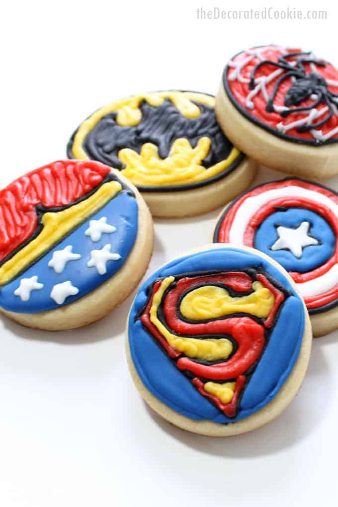 How to decorate bite-size superhero cookies for a superhero fan or a superhero birthday party. #SuperheroParty #SuperheroCookies #cookiedecorating