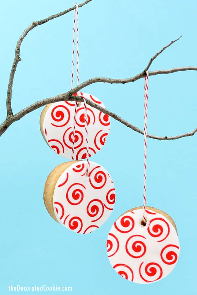 valentine's day cookie ornaments made with icing paper, fondant, and royal icing