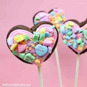 How to make crushed conversation heart cookies on a stick for Valentine's Day. #ValentinesDaycookies #heartcookies #cookiepops #conversationhearts