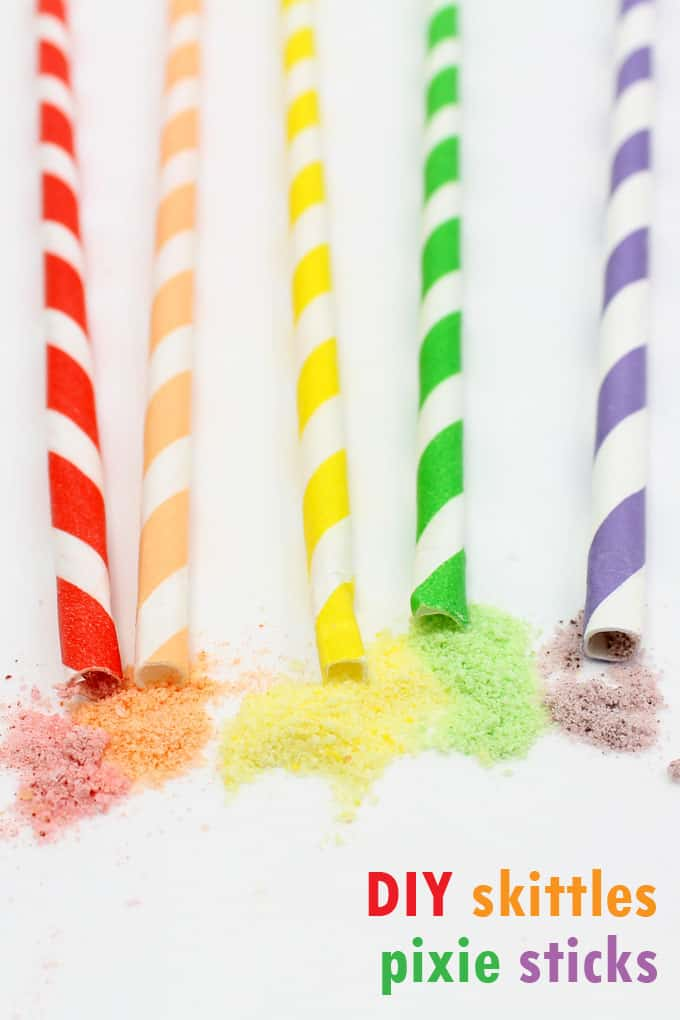 Homemade Pixie Sticks: How to make pixie sticks with ground Skittles Candy, packaged in a rainbow of paper straws. Great for a rainbow or unicorn party.