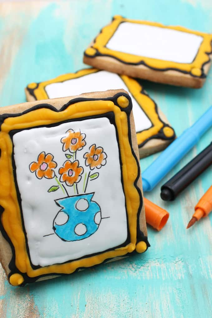 Art party favor idea: Decorate blank art canvas cookies to package as a party favor with food coloring pens so kids can decorate their own cookies.