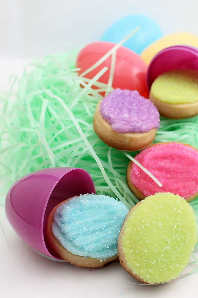 How to decorate mini Easter egg cookies. Quick and easy Easter cookie treat with cut-out sugar cookies, royal icing, and sprinkles.
