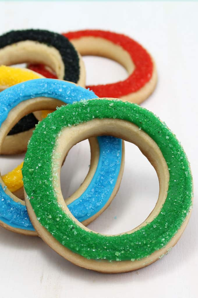These simple, sparkly Olympics rings cookies are an easy, fun food idea for your Olympics party. Perfect for the Winter or Summer Olympics. Video how-tos.