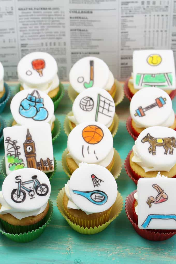 Olympics cupcakes: Top mini cupcakes with fondant cupcake toppers featured all of the sports drawn with food coloring pens.