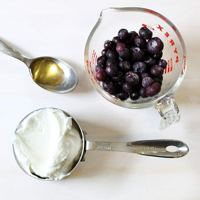 ingredients for frozen yogurt pops with blueberries and strawberries