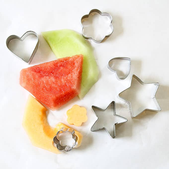 melon slices and cookie cutters