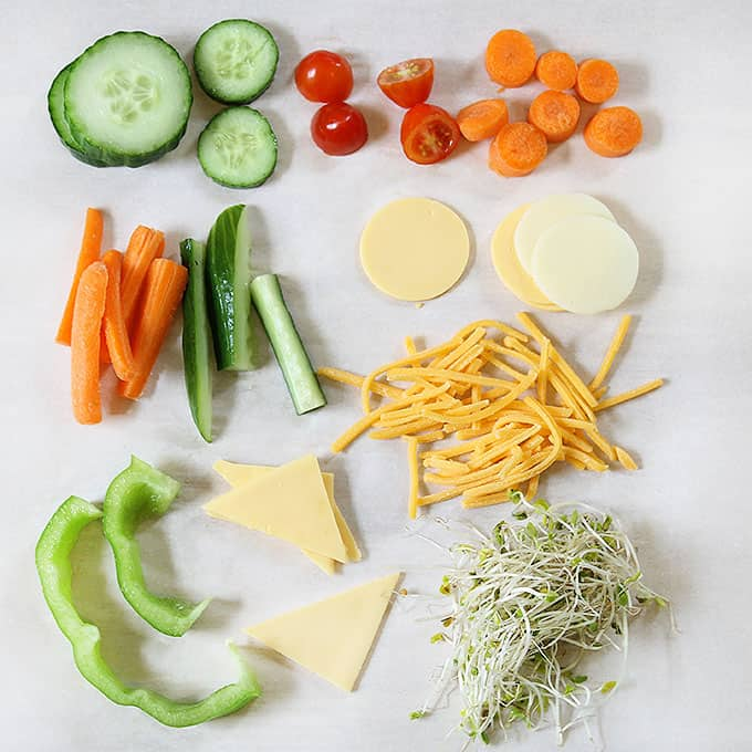 cut up vegetables and cheese for silly veggie faces