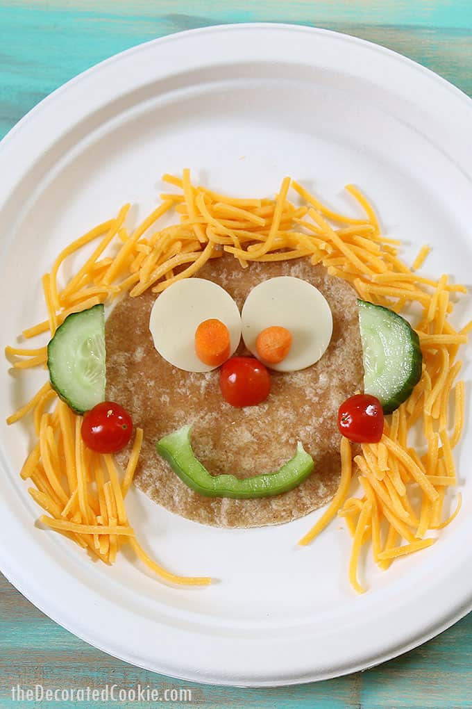 silly veggie faces with tortillas, cheese, and veggies