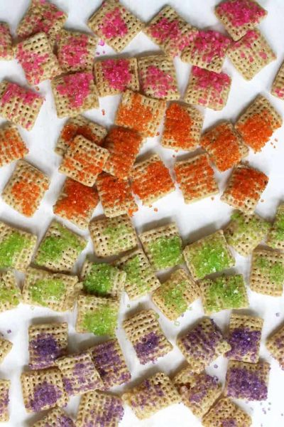 RAINBOW CHEX MIX: Coat chex cereal with colorful rainbow sprinkles to make a fun party snack. Great unicorn food or rainbow party treat.
