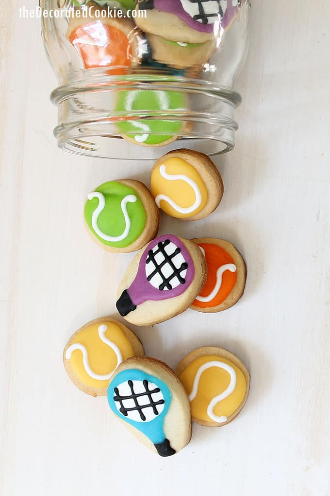 GIFT IDEA FOR A TENNIS PLAYER: bite-size, mini tennis ball and tennis racKet decorated tennis cookies packaged in a mason jar