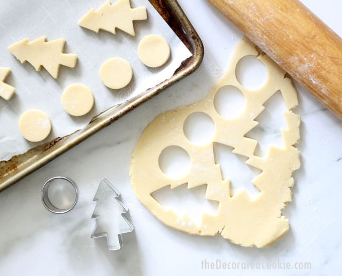 THE BEST CUT-OUT SUGAR COOKIE RECIPE for cookie decorating. No-spread, easy, perfect every time. Make your own sprinkle lollipop cookie pops. #cookiedecorating