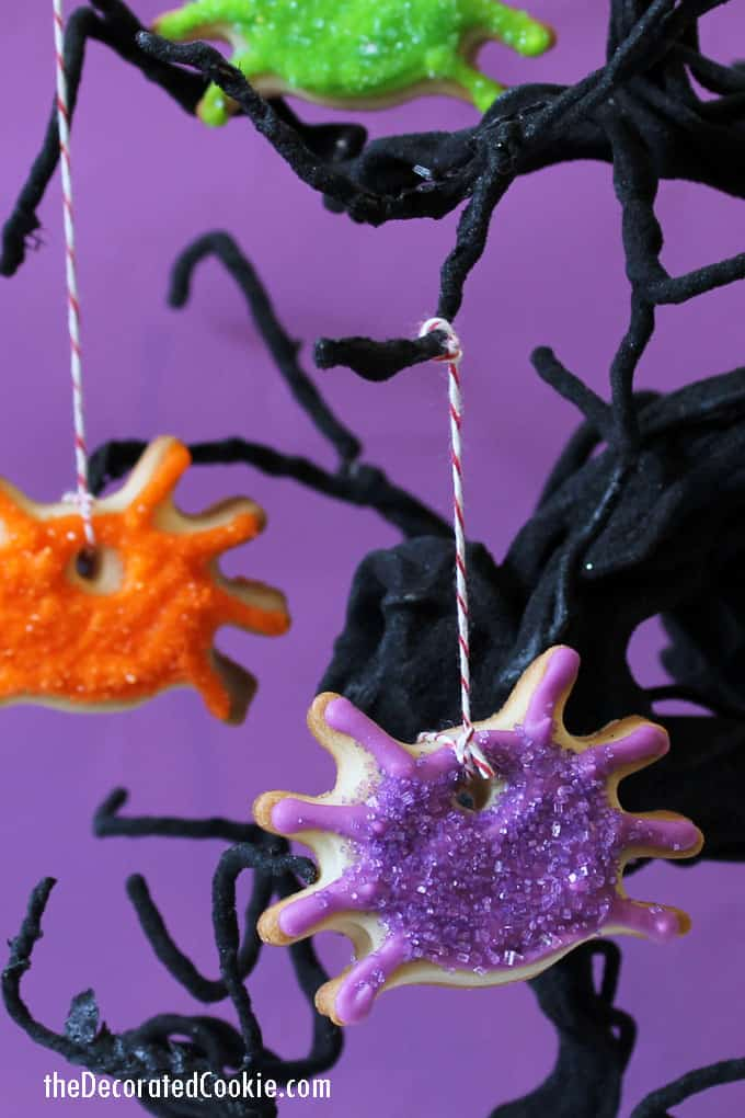 These dangling, sparkling spider ornament cookies double as a spooky Halloween treat AND as Halloween decor. #halloween #halloweenparty #cookies #decoratedcookies #spider #spidercookies #halloweendecor