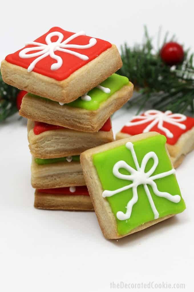 Step-by-step cookie decorating instructions to make bite-size Christmas present cookies. A simple, cute holiday cookie to give or serve at a holiday party