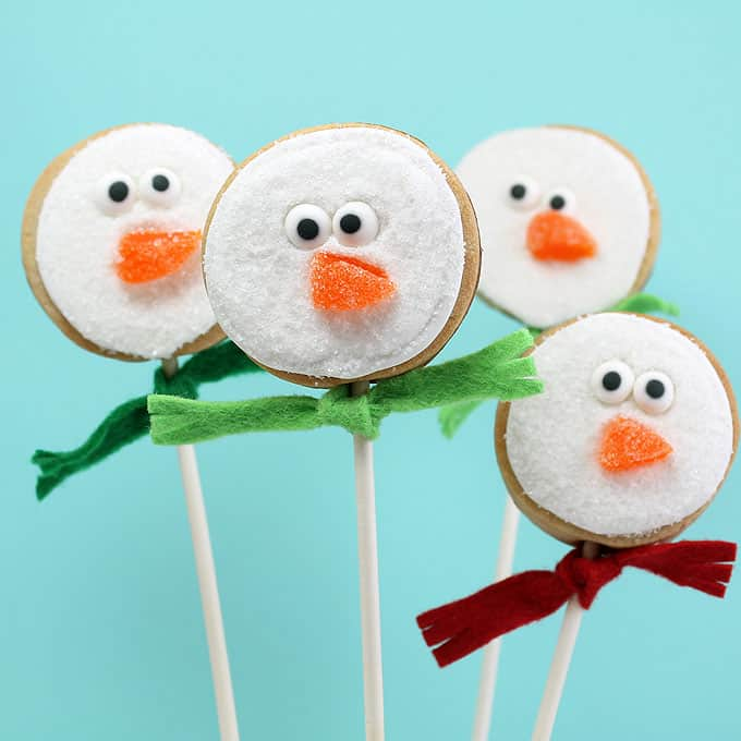 easy snowman cookies on a stick for simple Christmas cookie decorating
