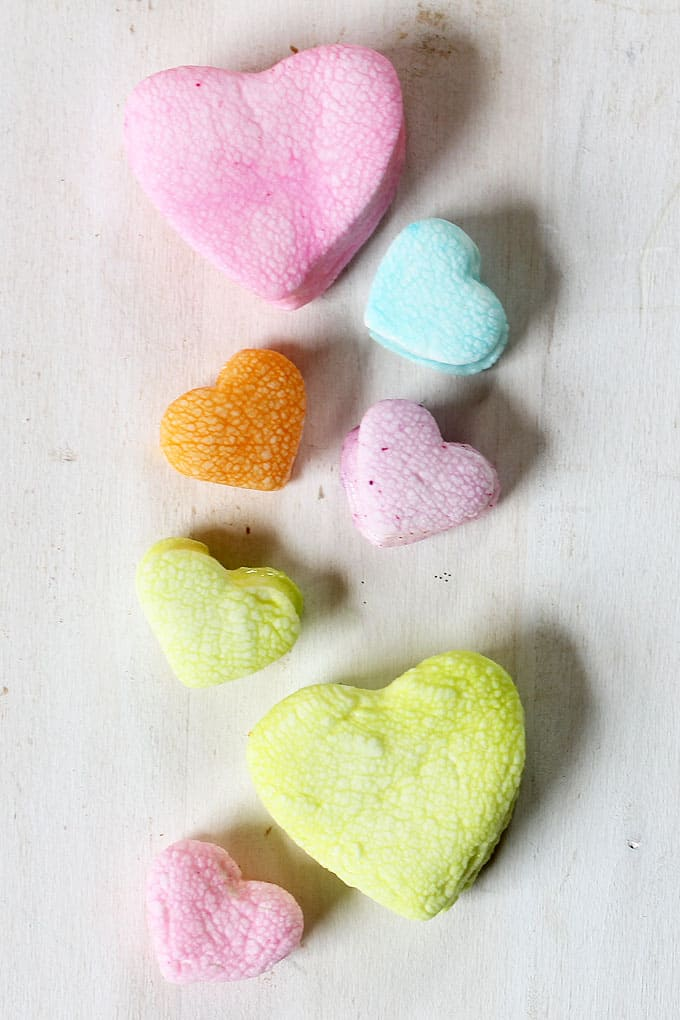 These dip-dyed pastel marshmallow hearts are a fun treat for Valentine's Day. They look just like the conversation candy.