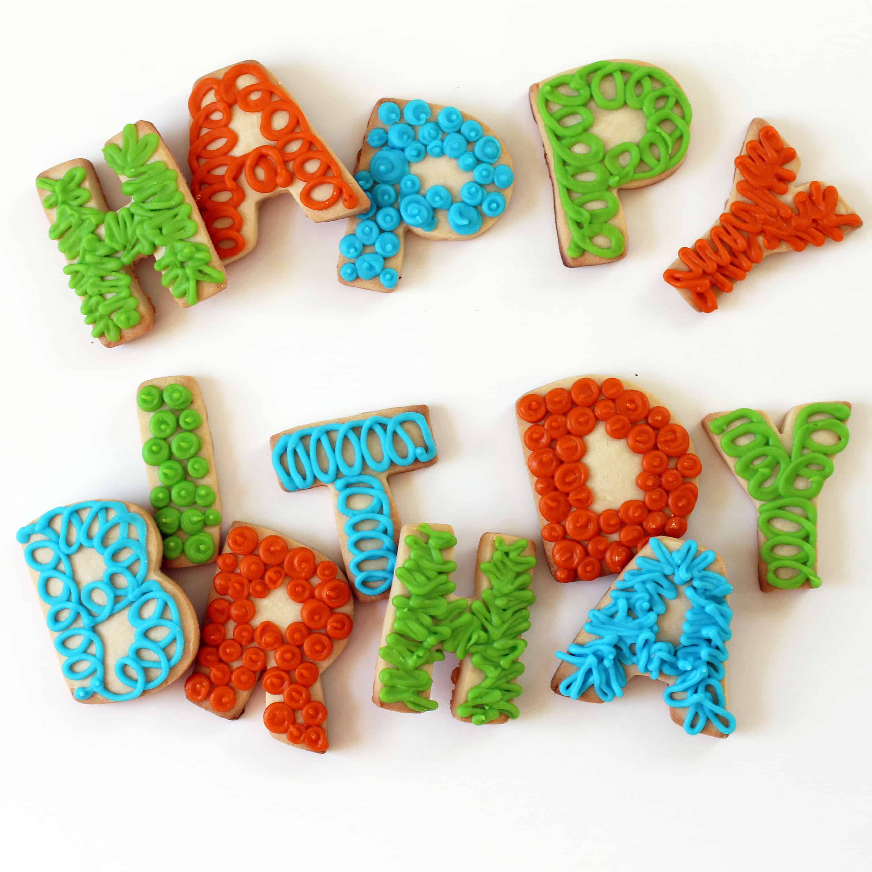 Spell out HAPPY BIRTHDAY LETTER COOKIES for a fun homemade birthday gift idea for any age. Decorate cookies with royal icing.