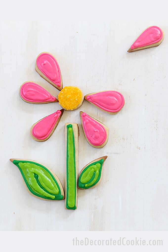 "FLOWER PUZZLE COOKIES Assemble the cookie petals, leaves and stems to make flowers for Spring. How to decorate flower ""puzzle"" cookies, a fun birthday cookie idea."