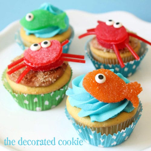 http://thedecoratedcookie.com/2012/05/gumdrop-crab-and-fish-cupcake-toppers/